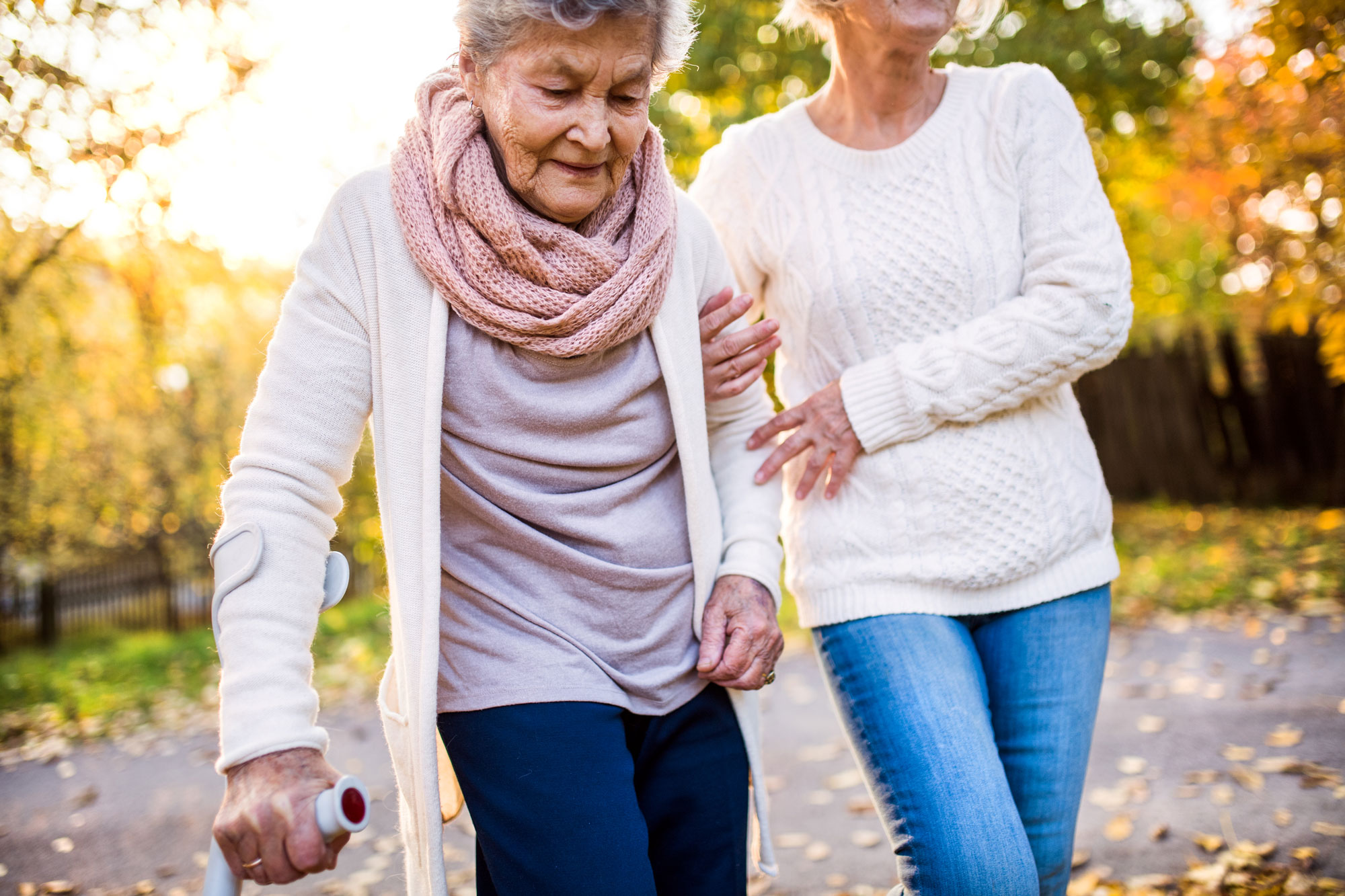 Elderly Woman Walking in Fall - Memory Care Home Solutions - Giving Back
